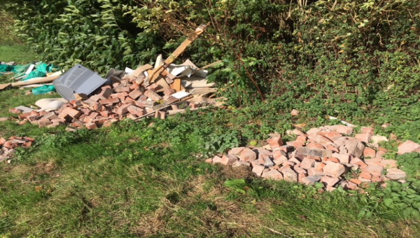 Photo of house renovation waste fly tipped in Madley