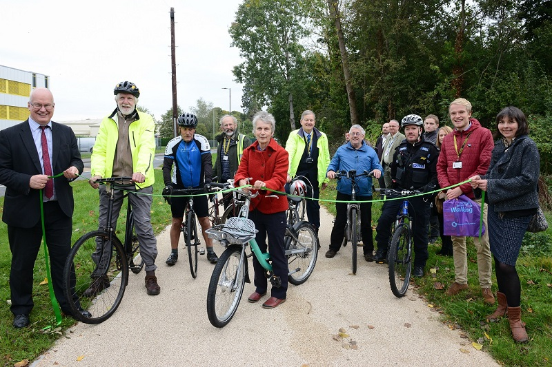 Councillor Trish Marsh cuts ribbon to open the new Straight Mile cycle path