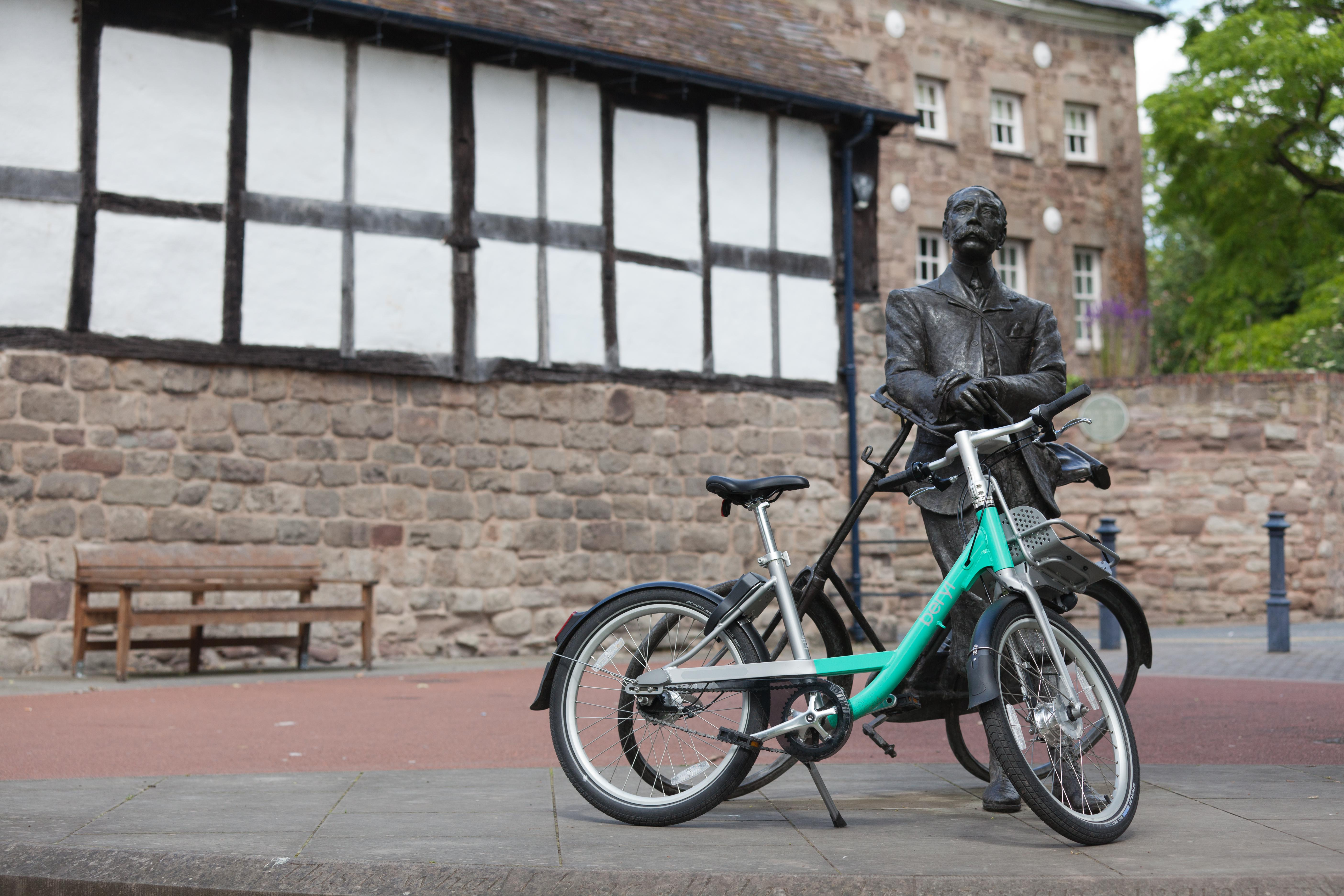 Beryl Bike leaning against statue of Elgar in Cathedral Close