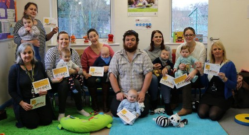 Parents and carers pictured with their children after starting the courses