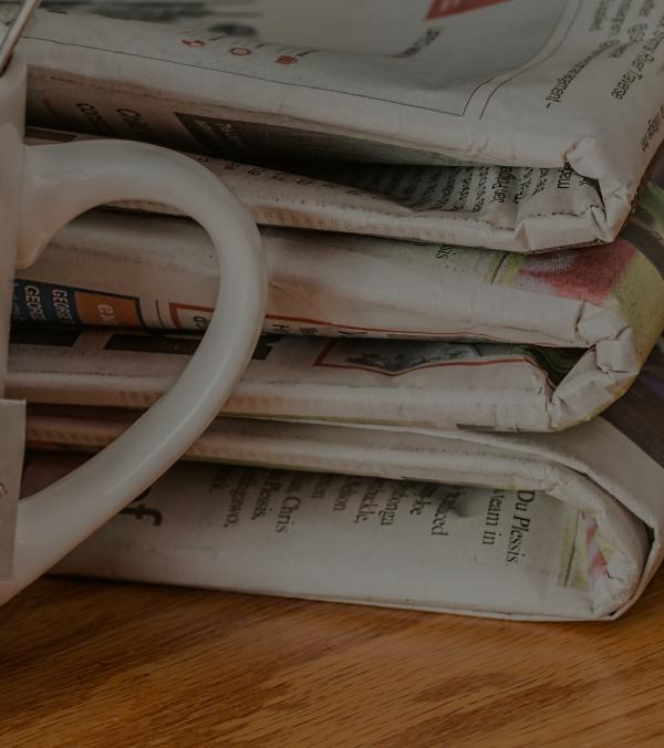 Newspapers and cup