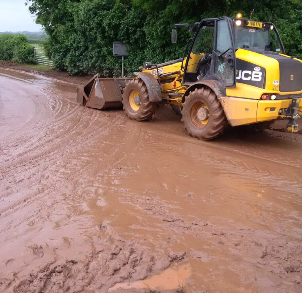 Soil water run off on a road caused by flooding