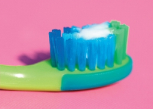 Image of toothbrush with smear of toothpaste suitable for child under 3 years