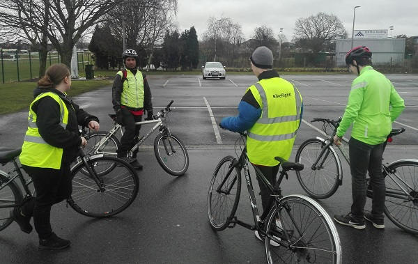 Attendees on bikes on a Two Wheels Aware course