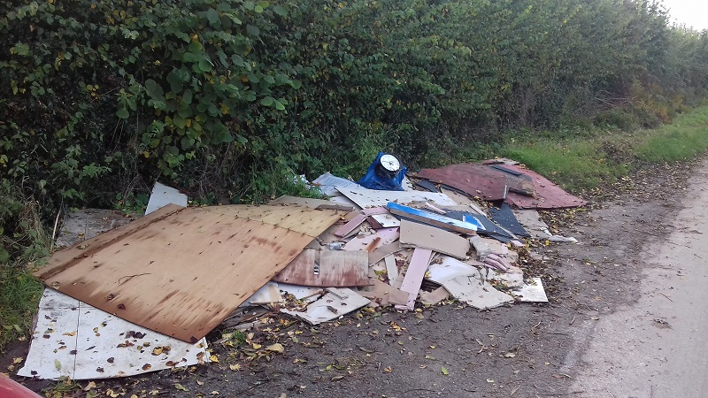 Fly tipped waste in Acton green