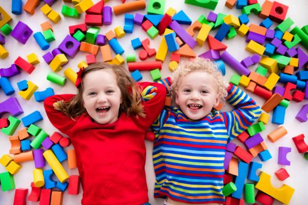 Children laughing in colourful bricks