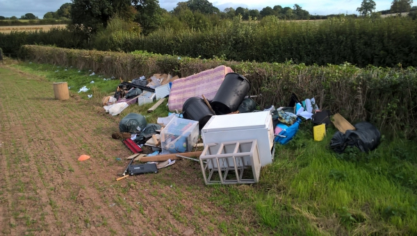 Photo of waste fly tipped in a Clehonger field